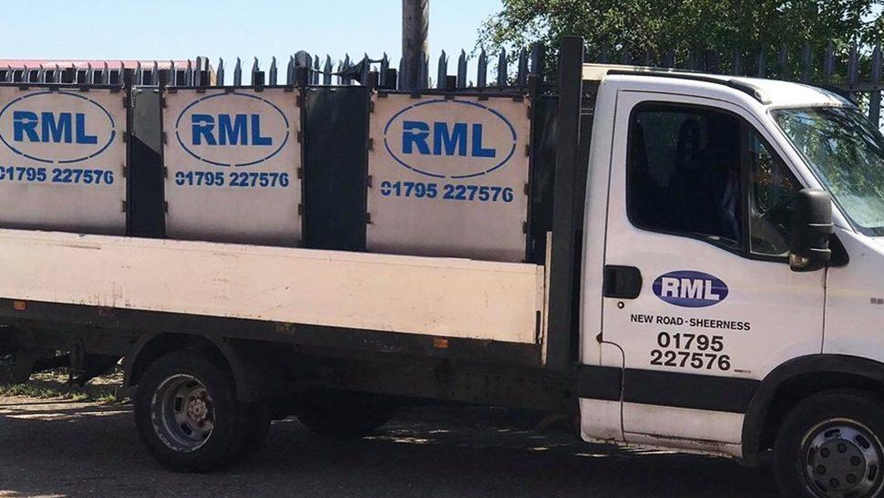 RML metal bins sitting on the back of a RML lorry