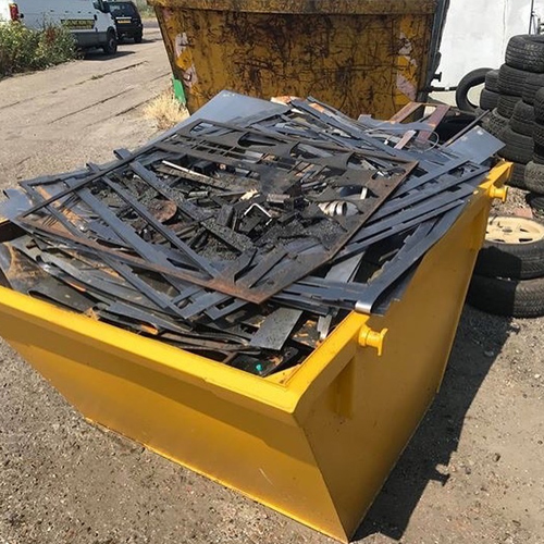 yelow skip filled with scrap metal