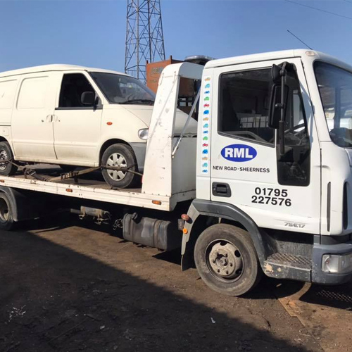 Recylcle Motors Kent Truck holding scrap van on back going to be recycled