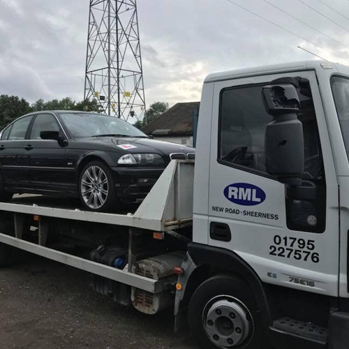 RML Kent truck with a BMW car on its back ready for recycling
